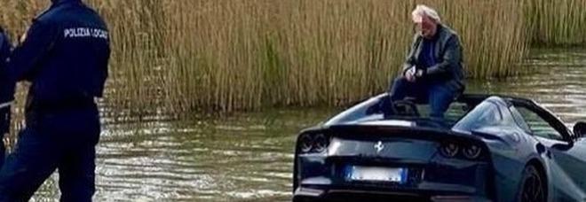 Dimentica la Ferrari in folle: il bolide finisce dentro al lago FOTO