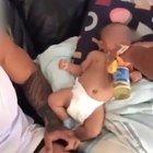 Neonato costretto a bere vodka, video choc. Il padre si difende: «Era solo un gioco»