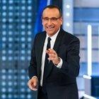 Carlo Conti a Tale e Quale Show conduce la semifinale in collegamento da casa. Elena Sofia Ricci, giurata d'eccezione